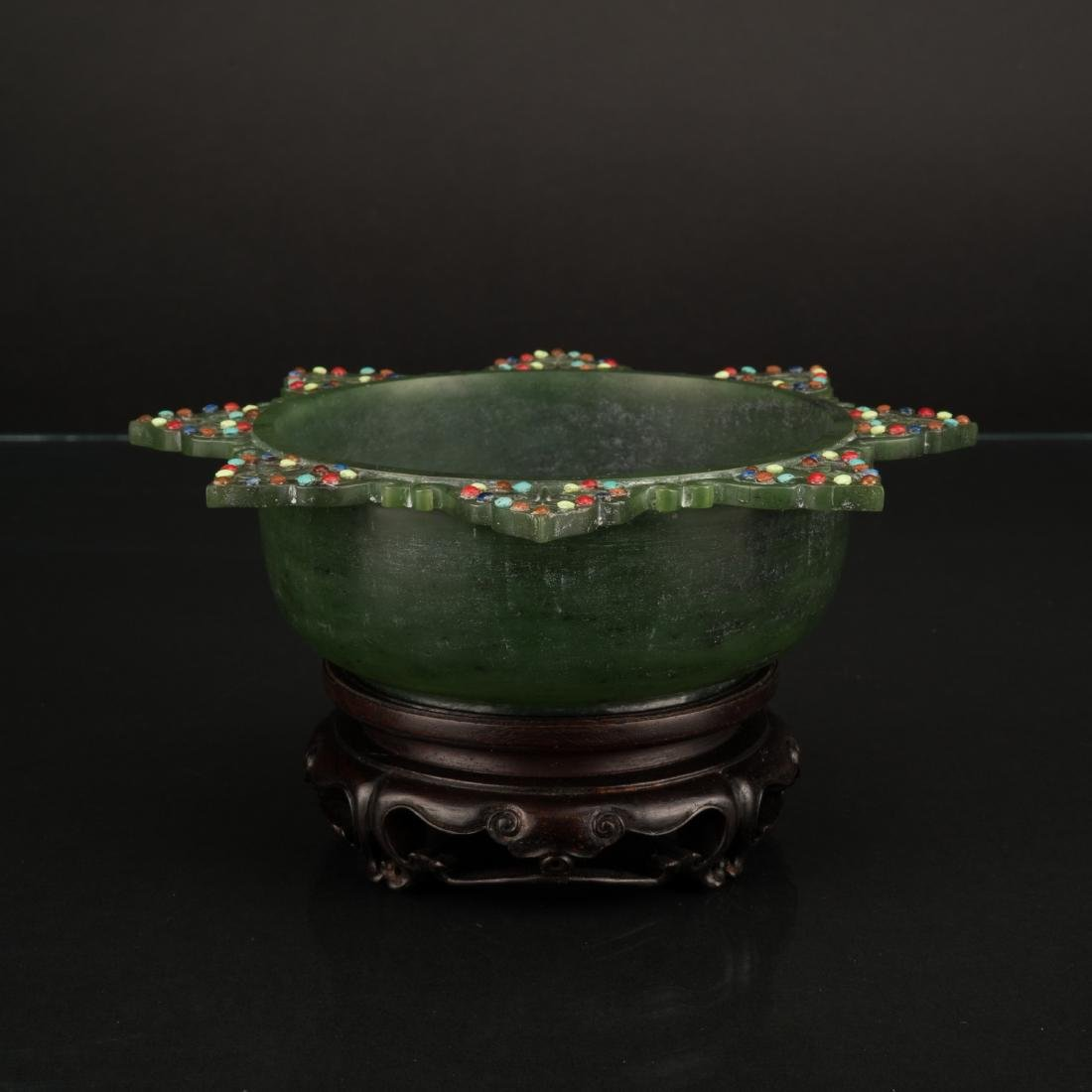 A GREEN JADE INLAID 8 CORNERED BOWL ON STAND