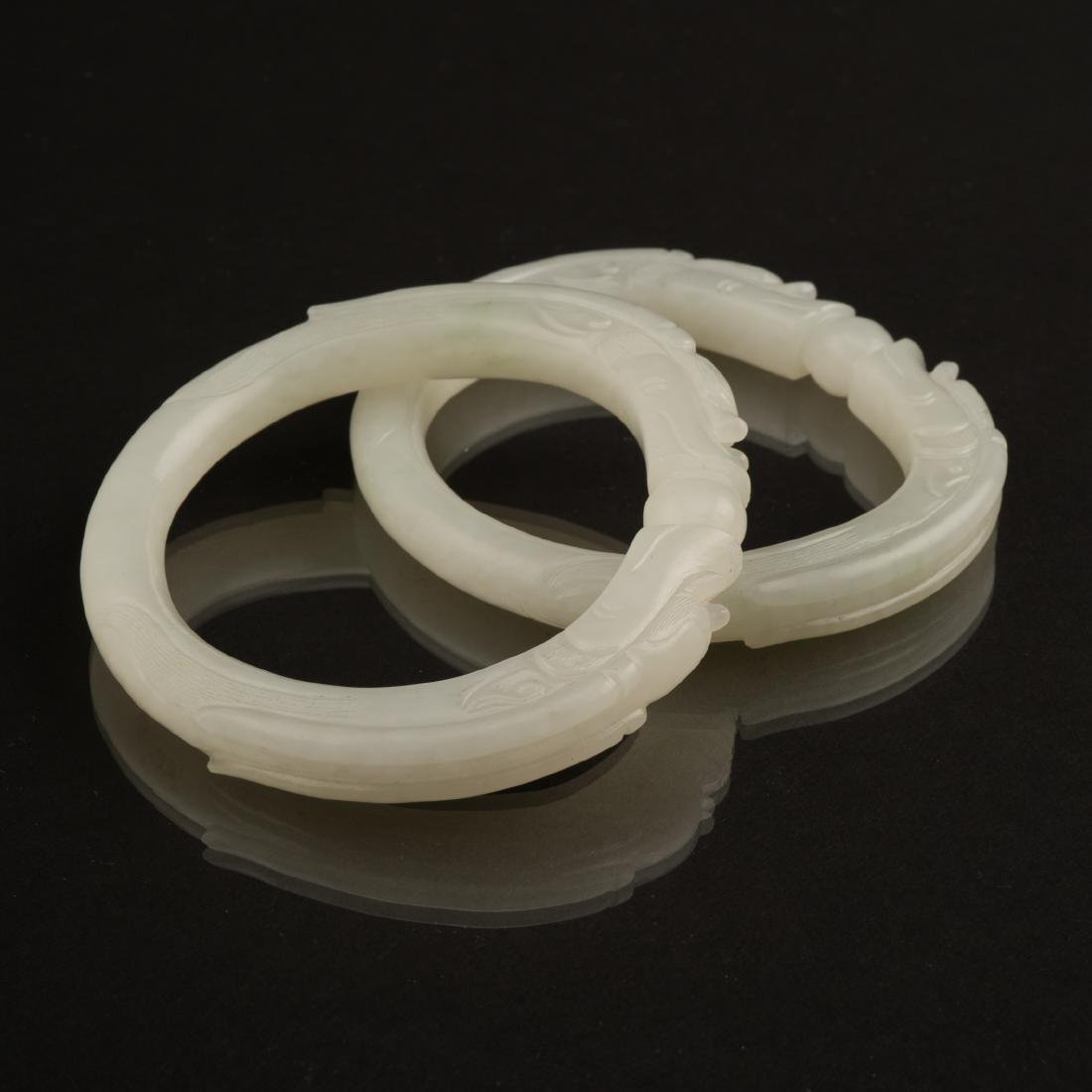 PAIR OF WHITE JADE DOUBLE DRAGONS BANGLES