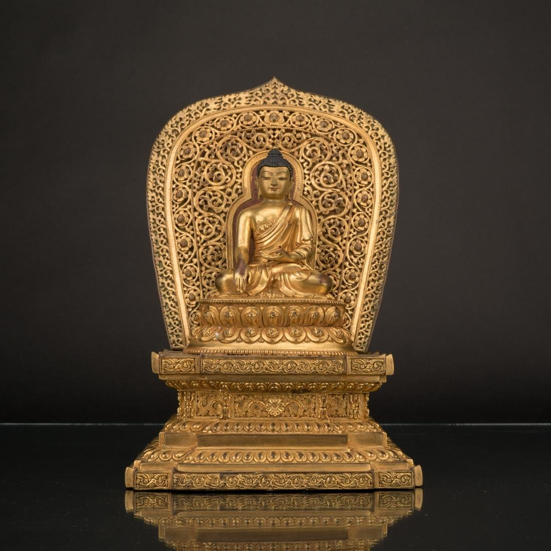 MING YONGLE GILT BRONZE BUDDHA WITH TORANA