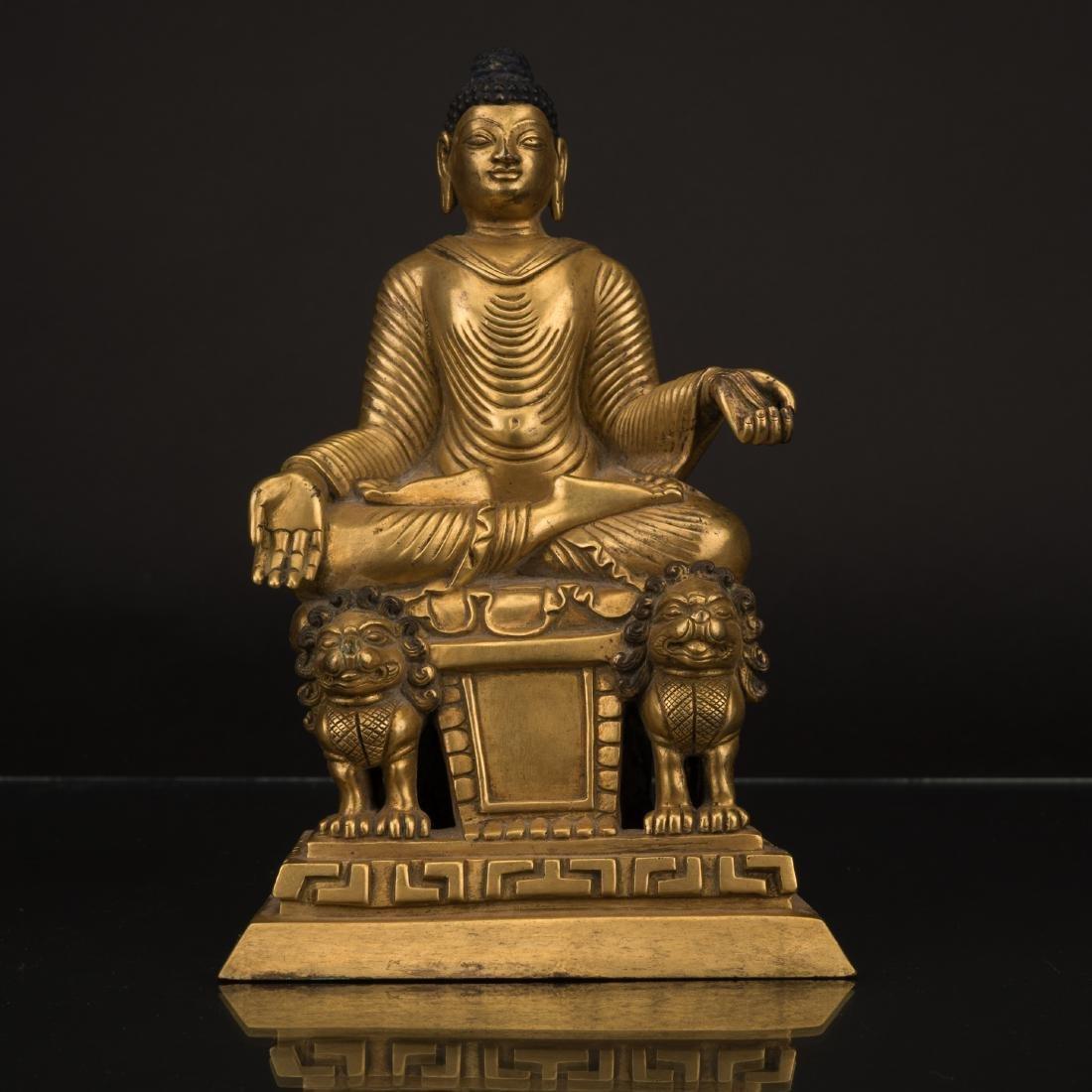 GILT BRONZE SANDALWOOD BUDDHA ON LION PEDESTAL