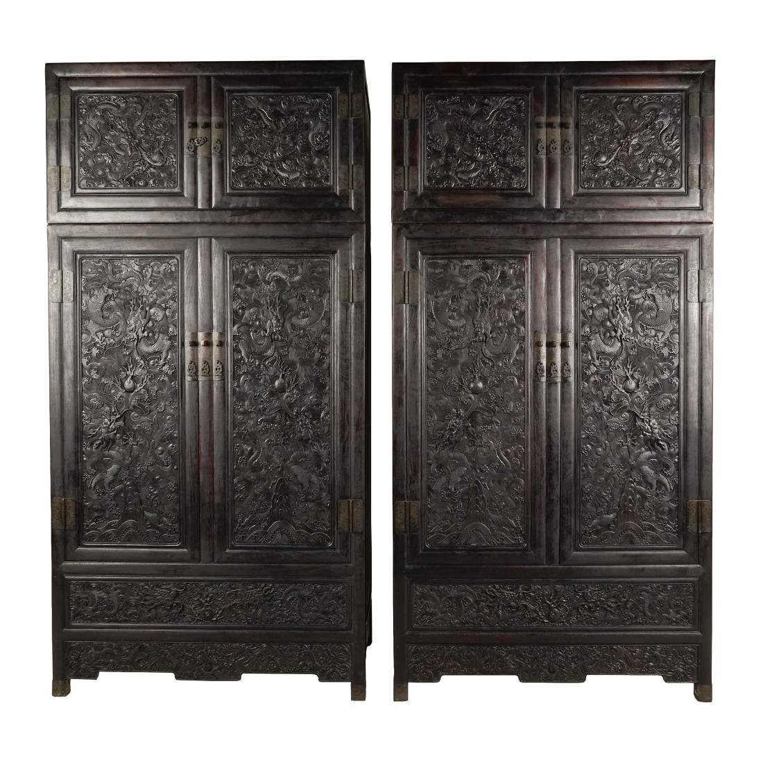 A PAIR OF ZITAN ARMOIRES WITH TOP-MOUNTED CABINETS