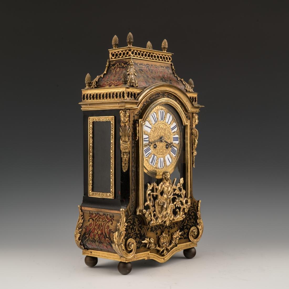 A LOUIS XVI-STYLE FAUX BOULLE FIGURAL BRACKET CLOCK