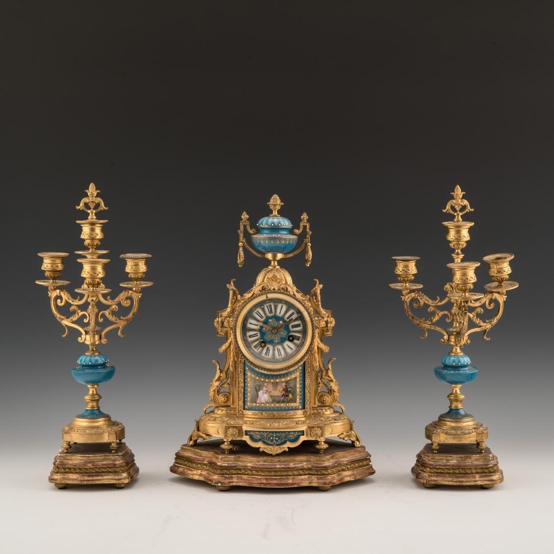 FRENCH GILT BRONZE AND PORCELAIN CLOCK GARNITURE