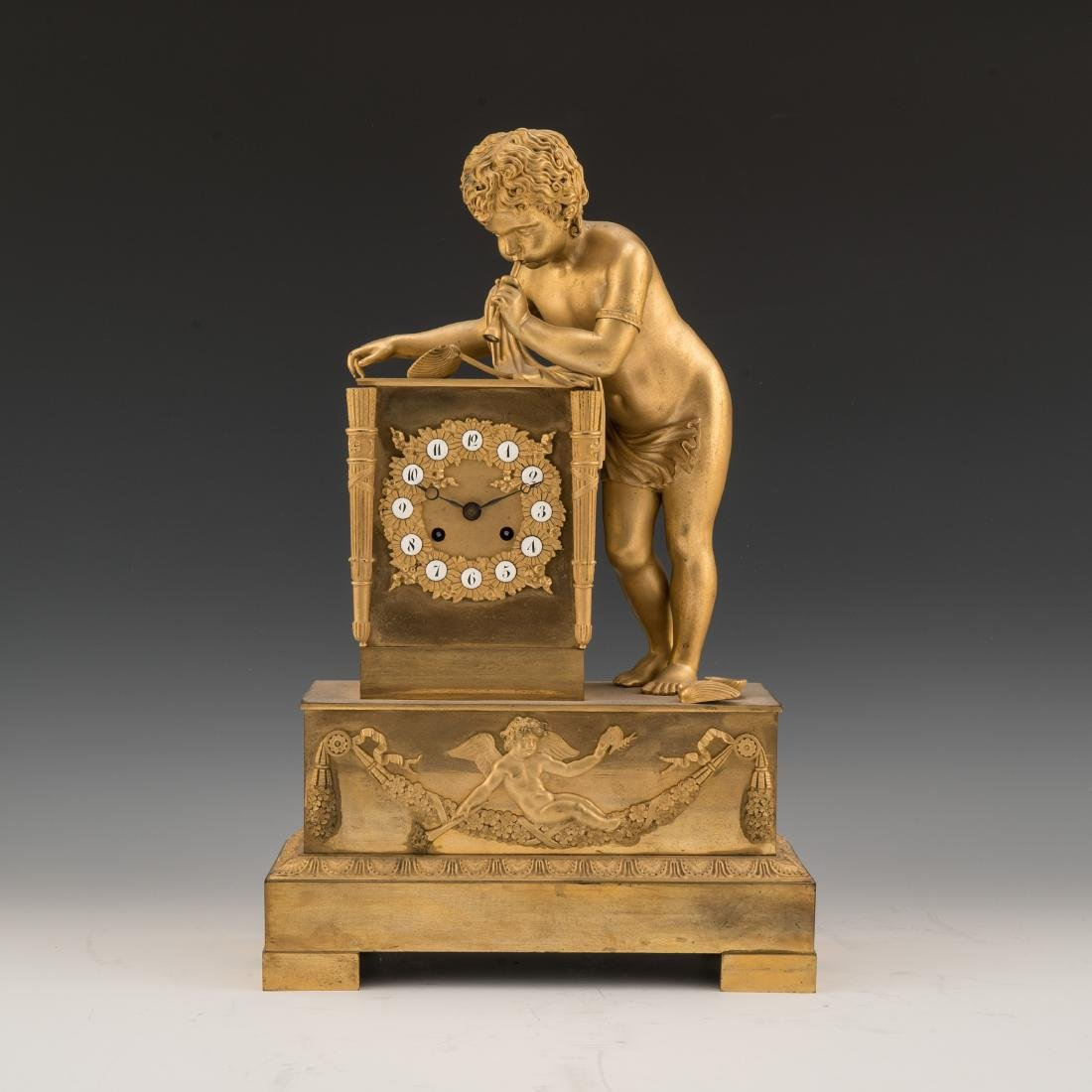 A FRENCH EMPIRE-STYLE GILT BRONZE FIGURAL MANTLE CLOCK,