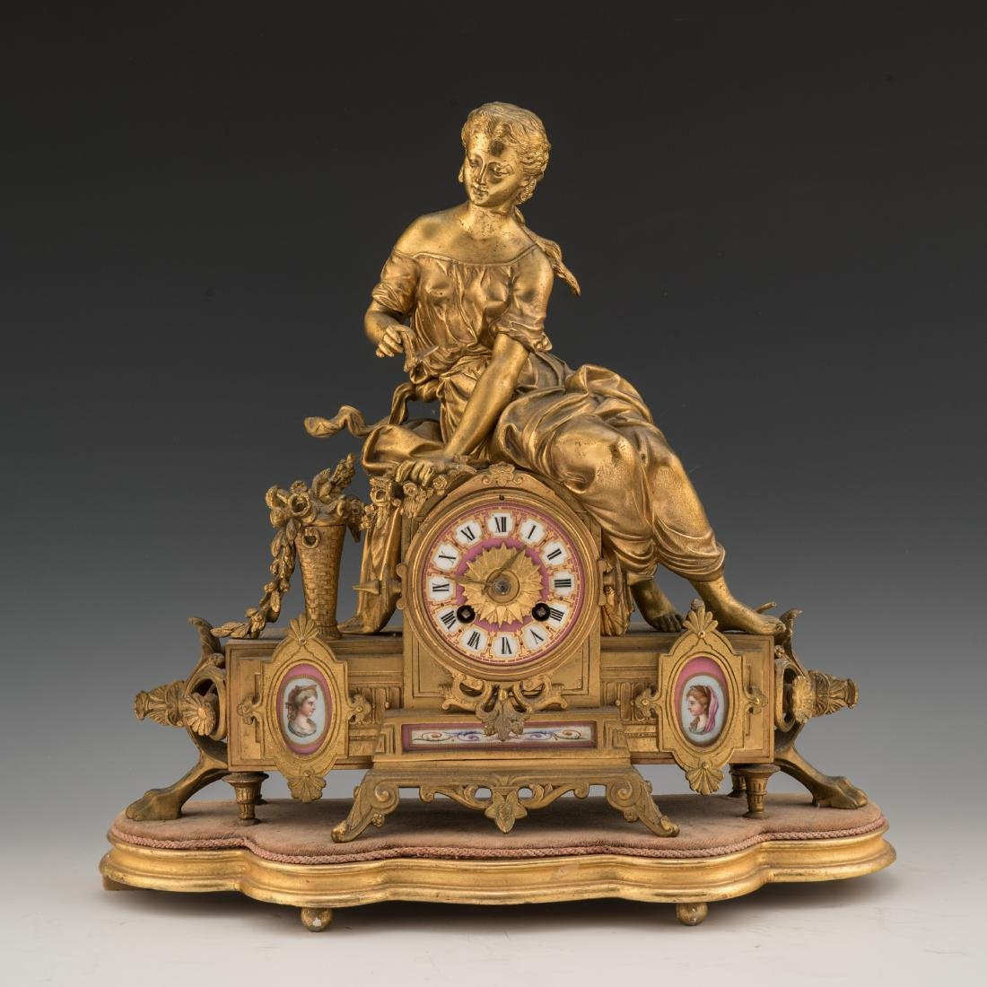 A 19TH CENTURY FRENCH LOUIS XVI-STYLE GILT BRONZE AND