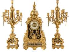 A LARGE LOUIS XVISTYLE BRONZE THREEPIECE CLOCK