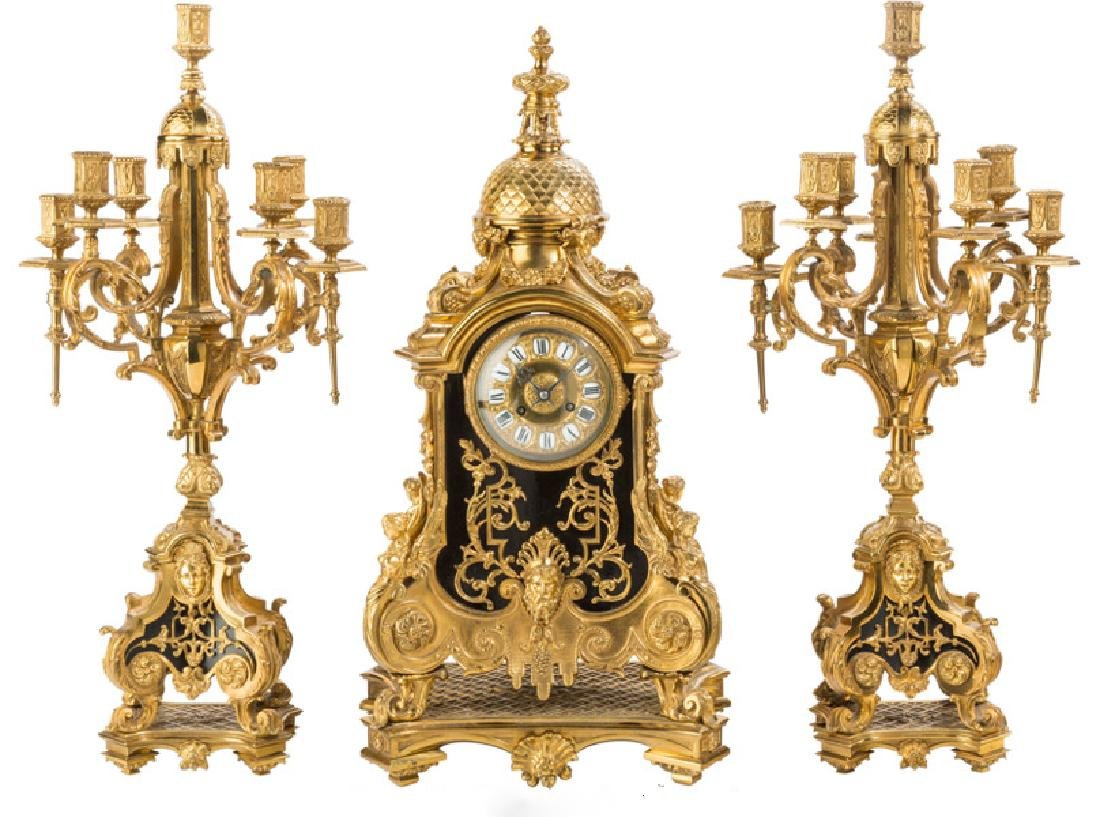 A LARGE LOUIS XVI-STYLE BRONZE THREE-PIECE CLOCK