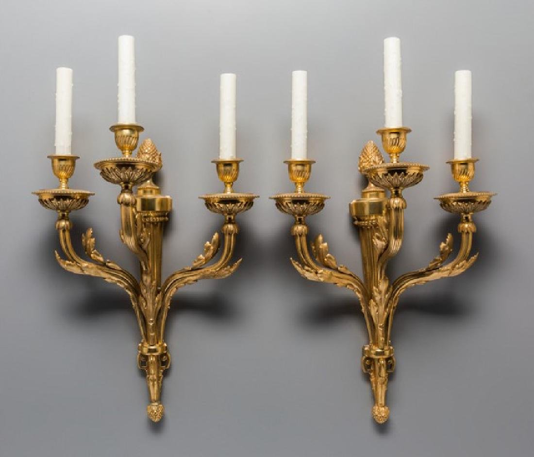 PAIR OF LOUIS XVI-STYLE GILT BRONZE THREE-LIGHT SCONCES