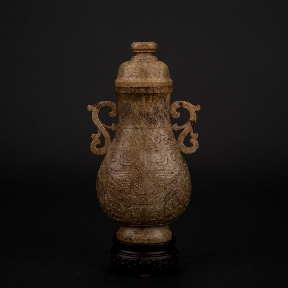 CHINESE JADE VASE IN ARCHAIC MOTIF ON STAND