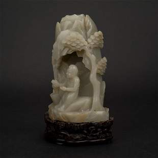 CARVED JADE DAMO IN GROTO ON STAND