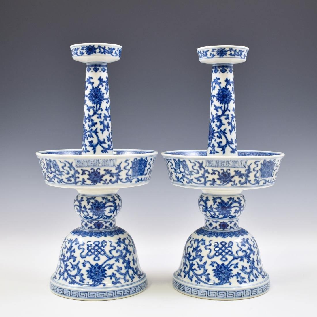 PAIR QIANLONG BLUE & WHITE WRAPPED FLORAL CANDLE STANDS