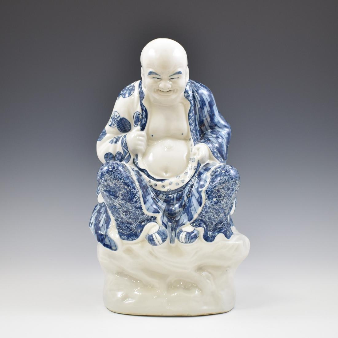 BLUE UNDERGLAZE PORCELAIN SEATED BUDDHA