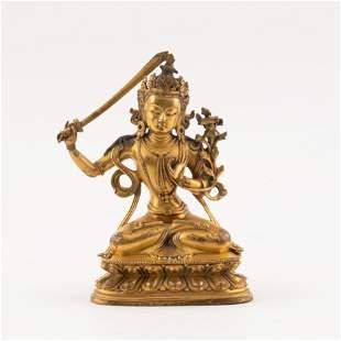 A MING GILT BRONZE BUDDHA FIGURE WITH A SWORD