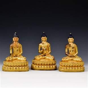 SET OF 3 QING GILT BRONZE SHAKYAMUNI BUDDHAS