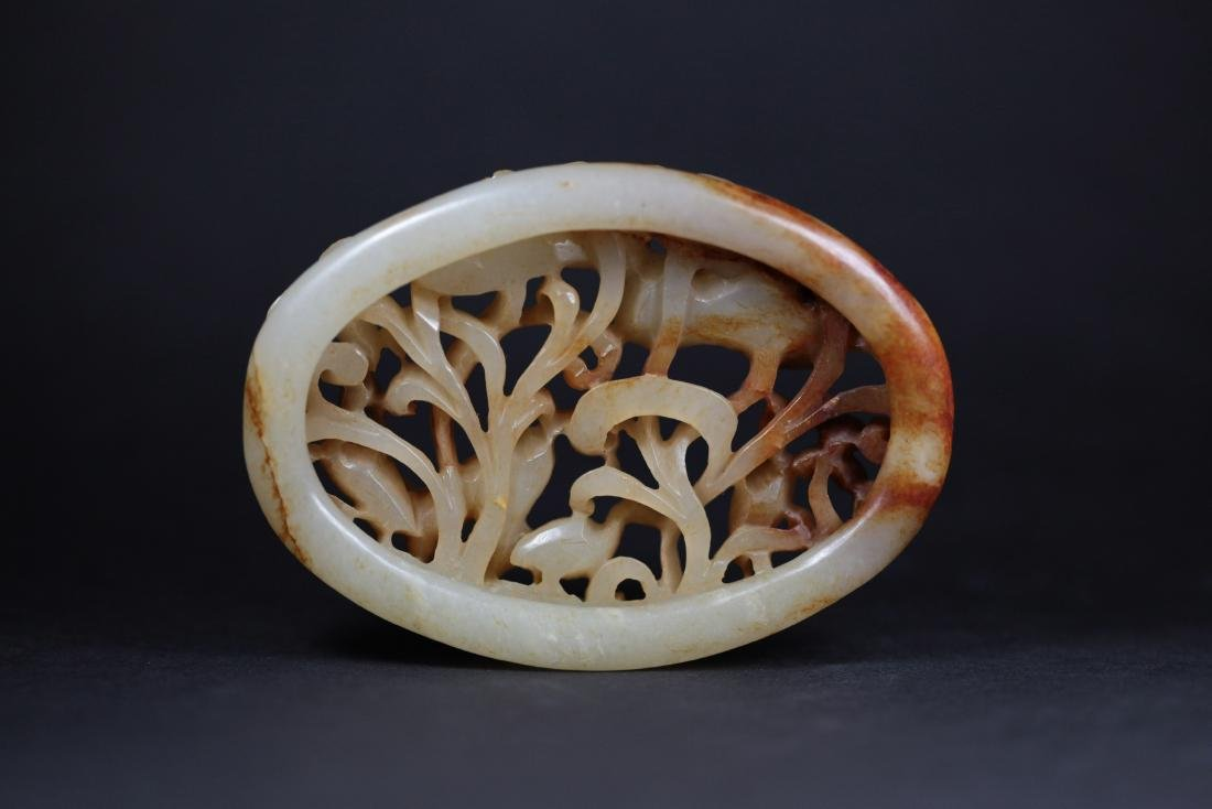 A WHITE JADE ORNAMENT       YUAN DYNASTY - 2