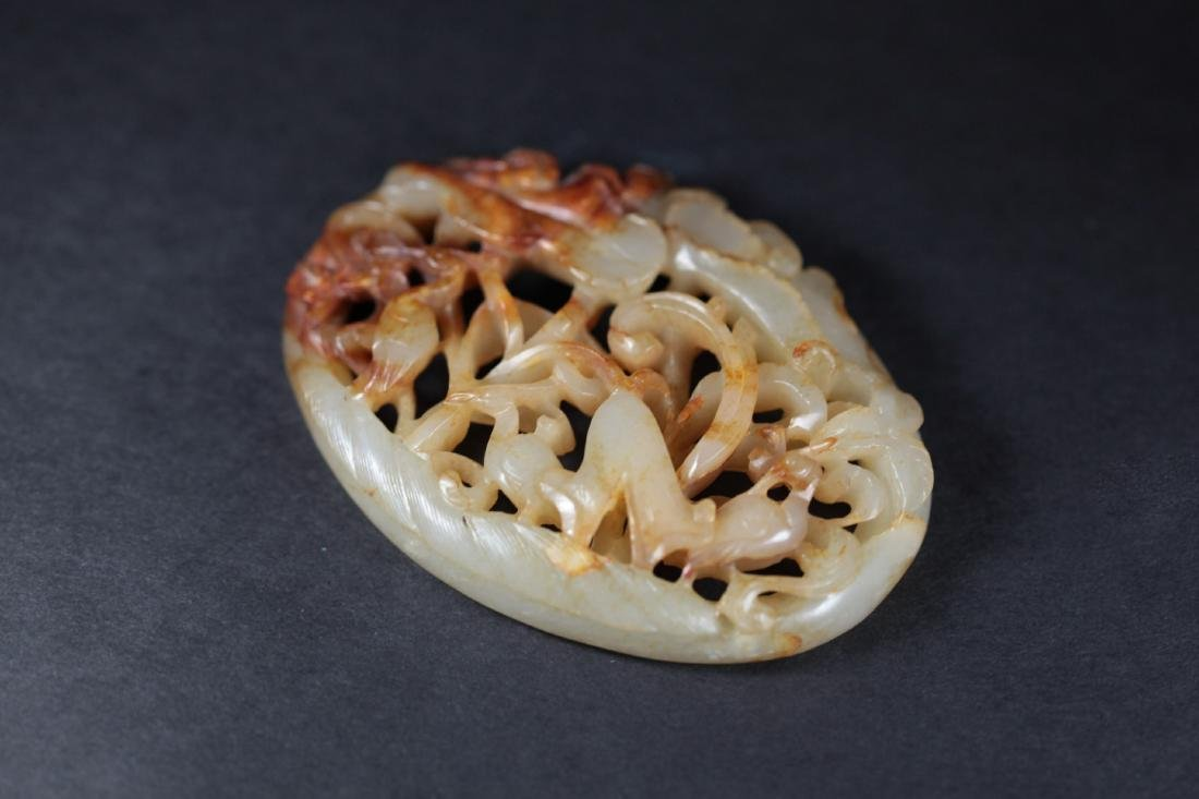 A WHITE JADE ORNAMENT       YUAN DYNASTY - 6