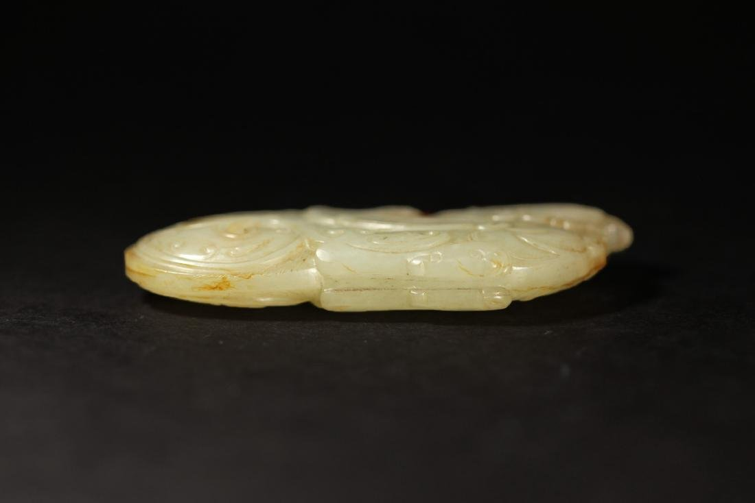 A WHITE AND RUSSET JADE PHOENIX PENDANT - 5