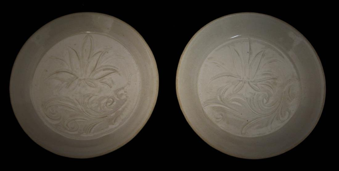 PAIR OF WHITE GLAZED AND CARVED DISHES