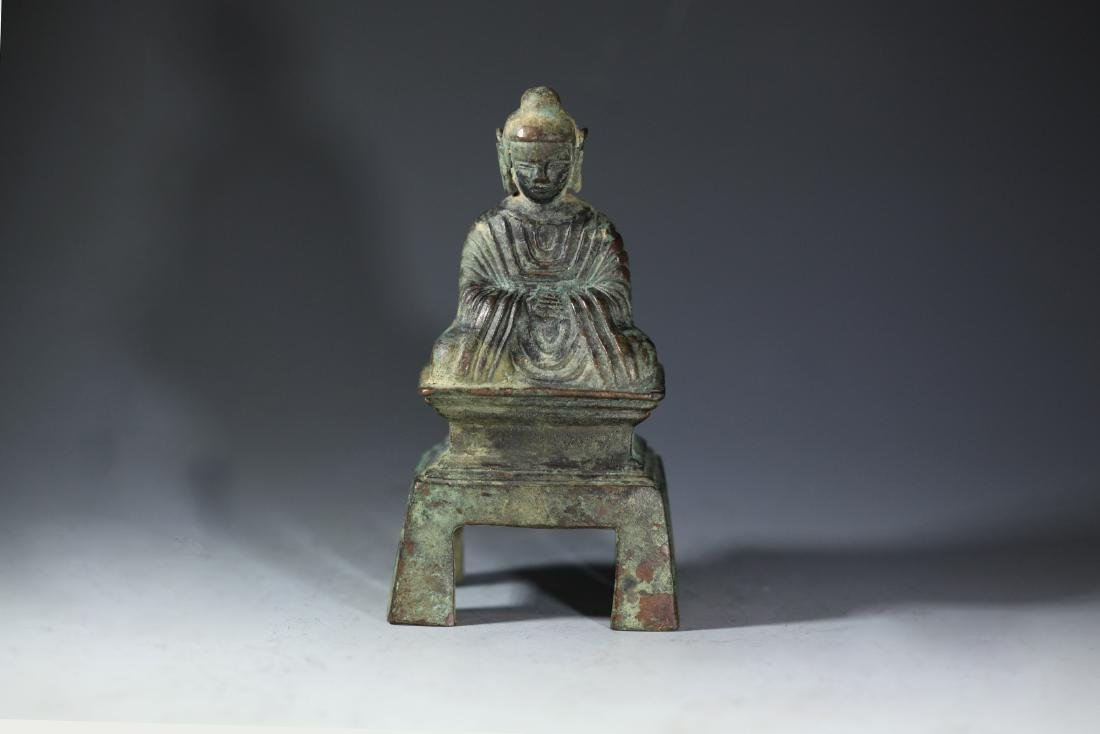 A BRONZE SEATED FIGURE OF BUDDHA