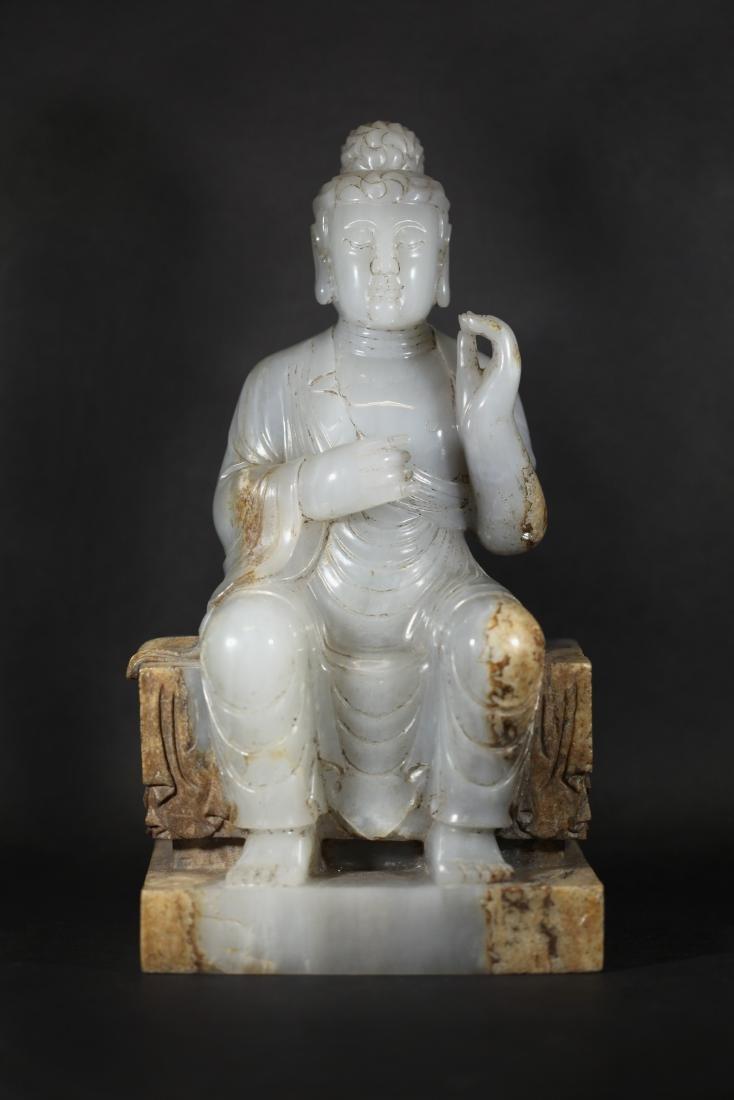 A WHITE JADE SEATED FIGURE OF BUDDHA         TANG DYNA