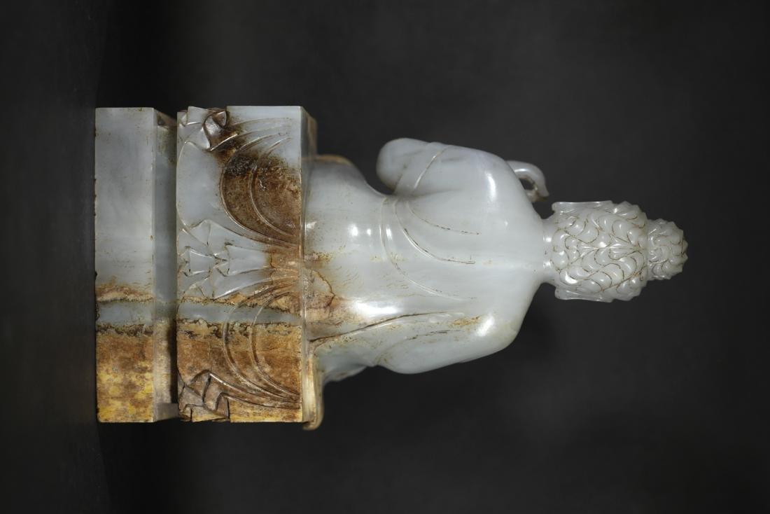 A WHITE JADE SEATED FIGURE OF BUDDHA         TANG DYNA - 3