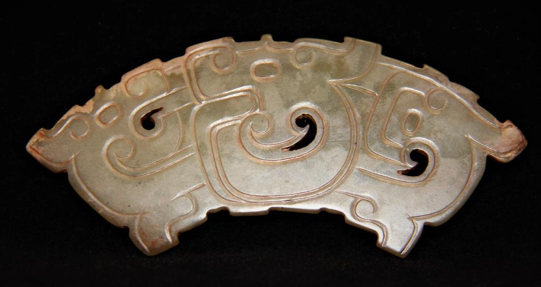 A JADE CARVED DRAGON HUANG PENDANT - 2