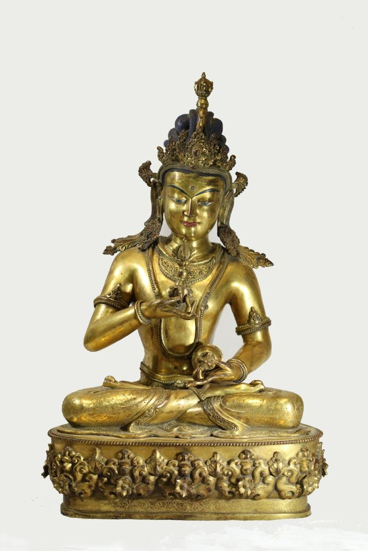A GILT-BRONZE FIGURE OF BUDDHA     MING DYNASTY