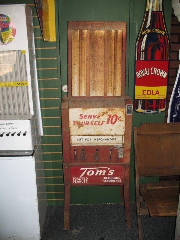 11: TOMS PEANUT COIN-OP VENDING MACHINE
