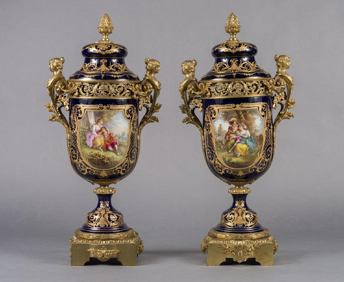 Pair Of French Sevres Style Gilt Mounted Lidded Urns