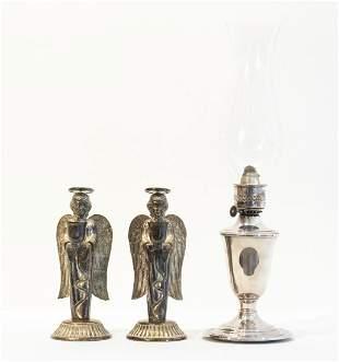 Kerosene Lamp and Pair of Angel-Themed Candlesticks