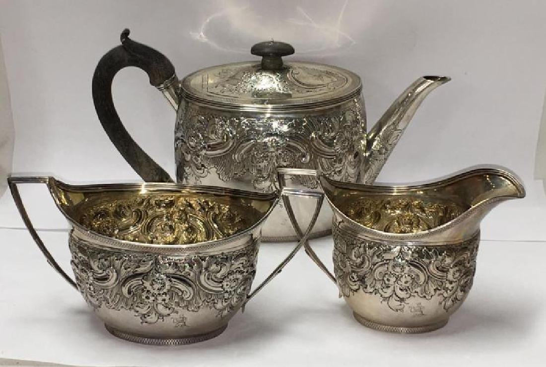 George III English Sterling Silver RepoussŽ Tea Set (3