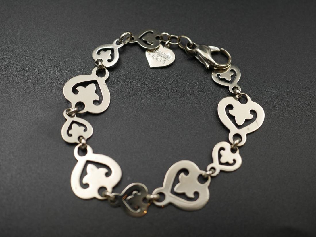 OJ PERRIN - Bracelet articulé en or gris à motif de cœu