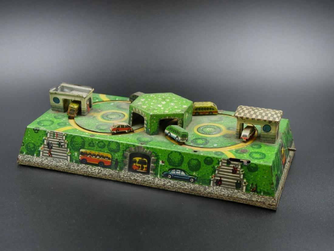Petit jouet en tôle à remontage manuel - Circuit de bus