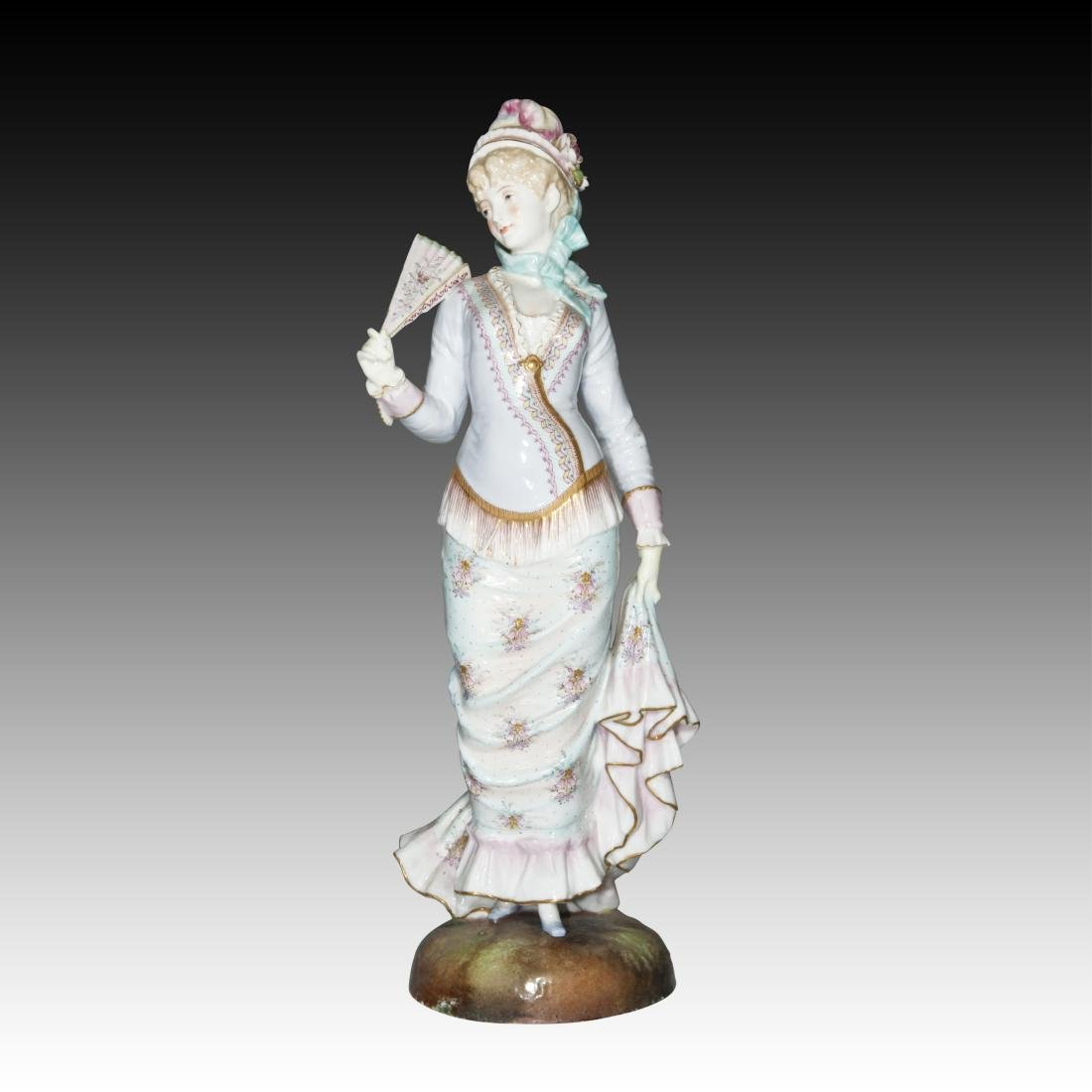 English Ceramic Figurine of a woman with a Fan