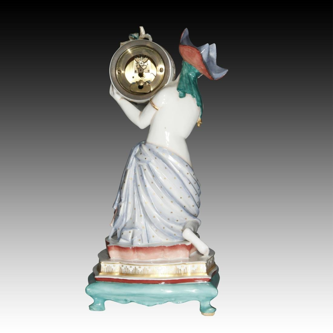 Female Semi-nude Figurine carrying a Clock - 2