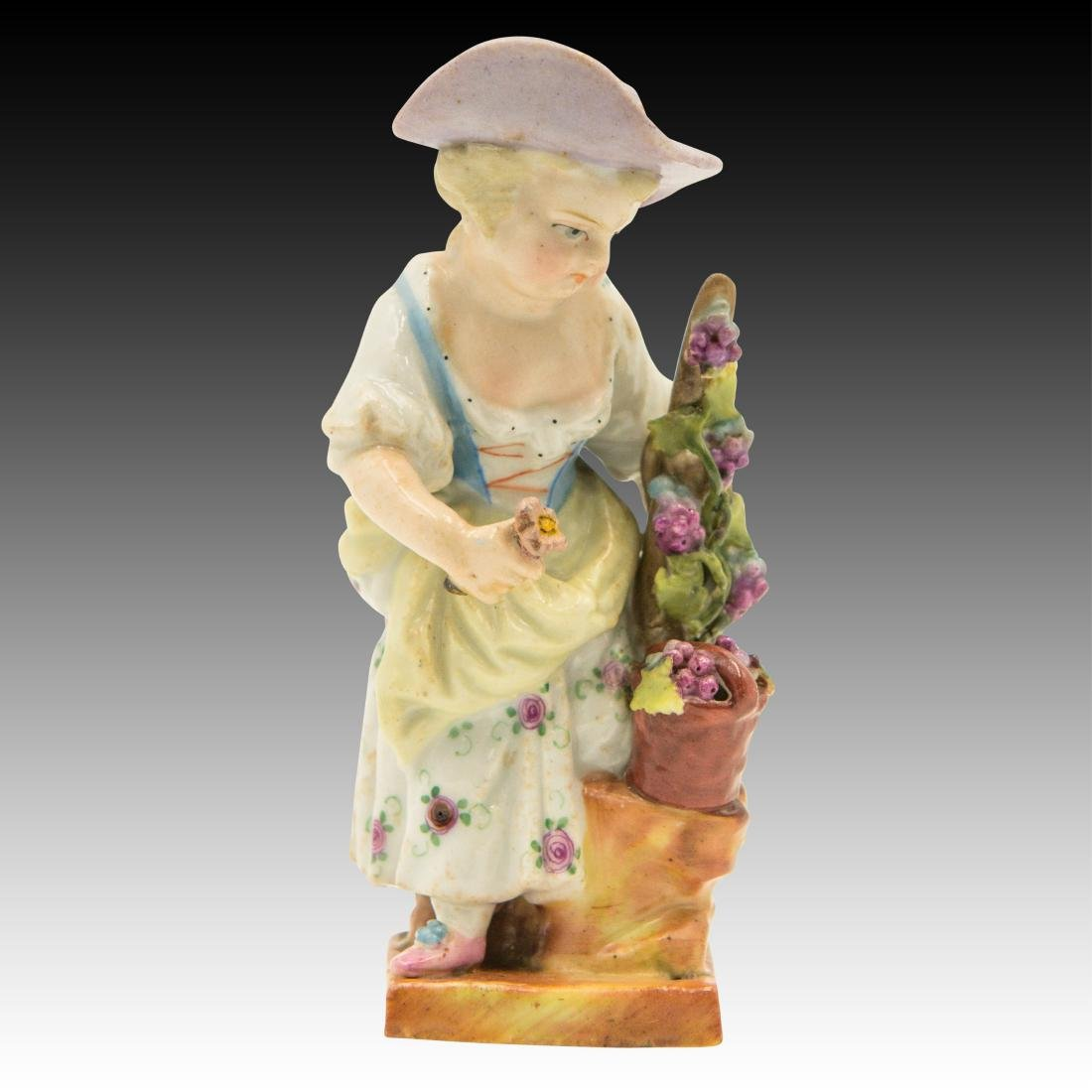 Small Figurine of a Young Girl with Flowers