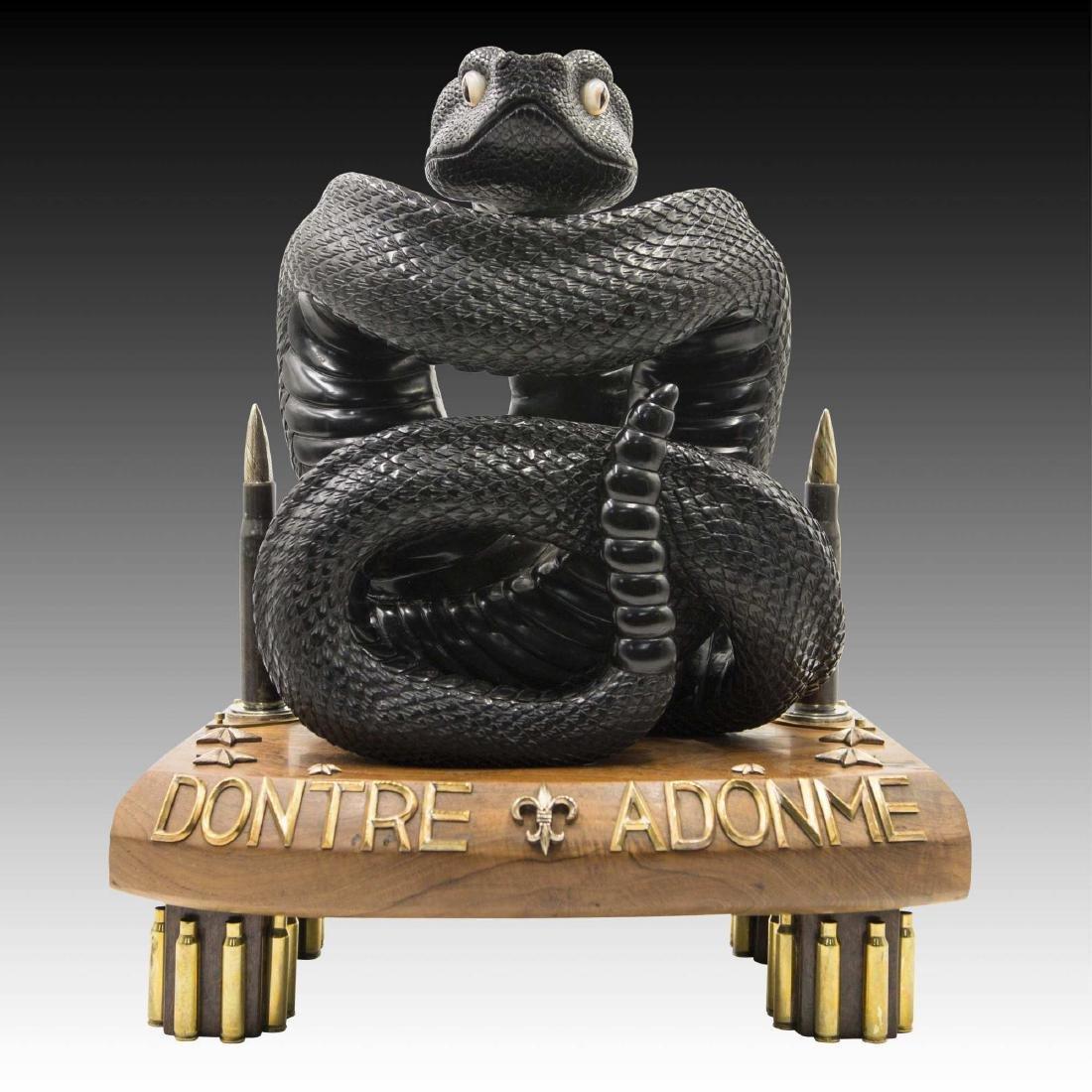 Carved Fossil Black Jet Rattlesnake by Lee Downey