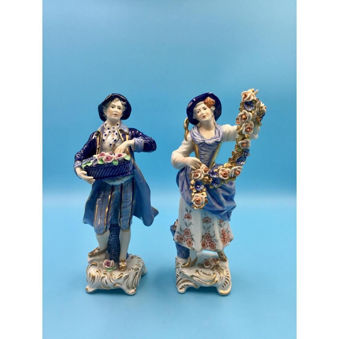 PAIR OF GERMAN PORCELAIN COUPLE FIGURINES