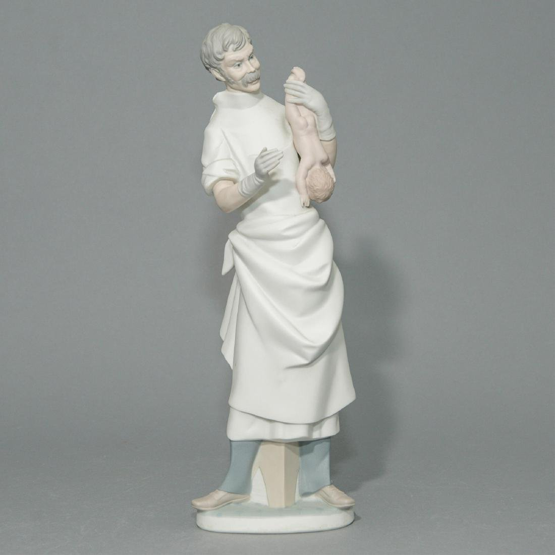 LLADRO OBSTETRICIAN PORCELAIN FIGURINE