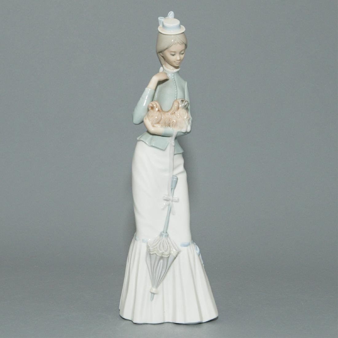 LLADRO WALK WITH THE DOG FIGURINE 4893