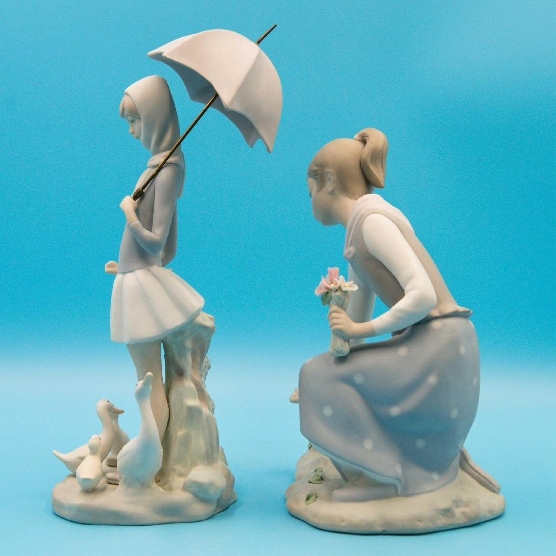 LLADRO GIRL GATHERS FLOWERS AND GIRL WITH UMBRELLA - 2