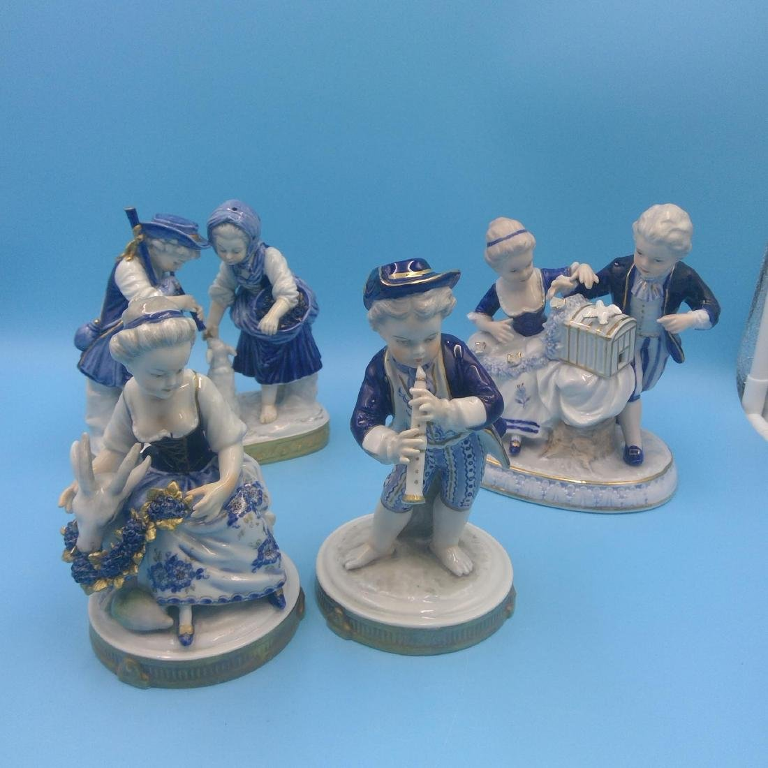 GROUP OF 4 ANTIQUE GERMAN PORCELAIN FIGURINES