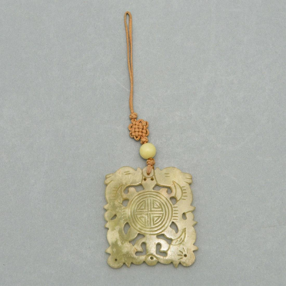 CARVED JADE NECKLACE ON DECORATIVE CORD