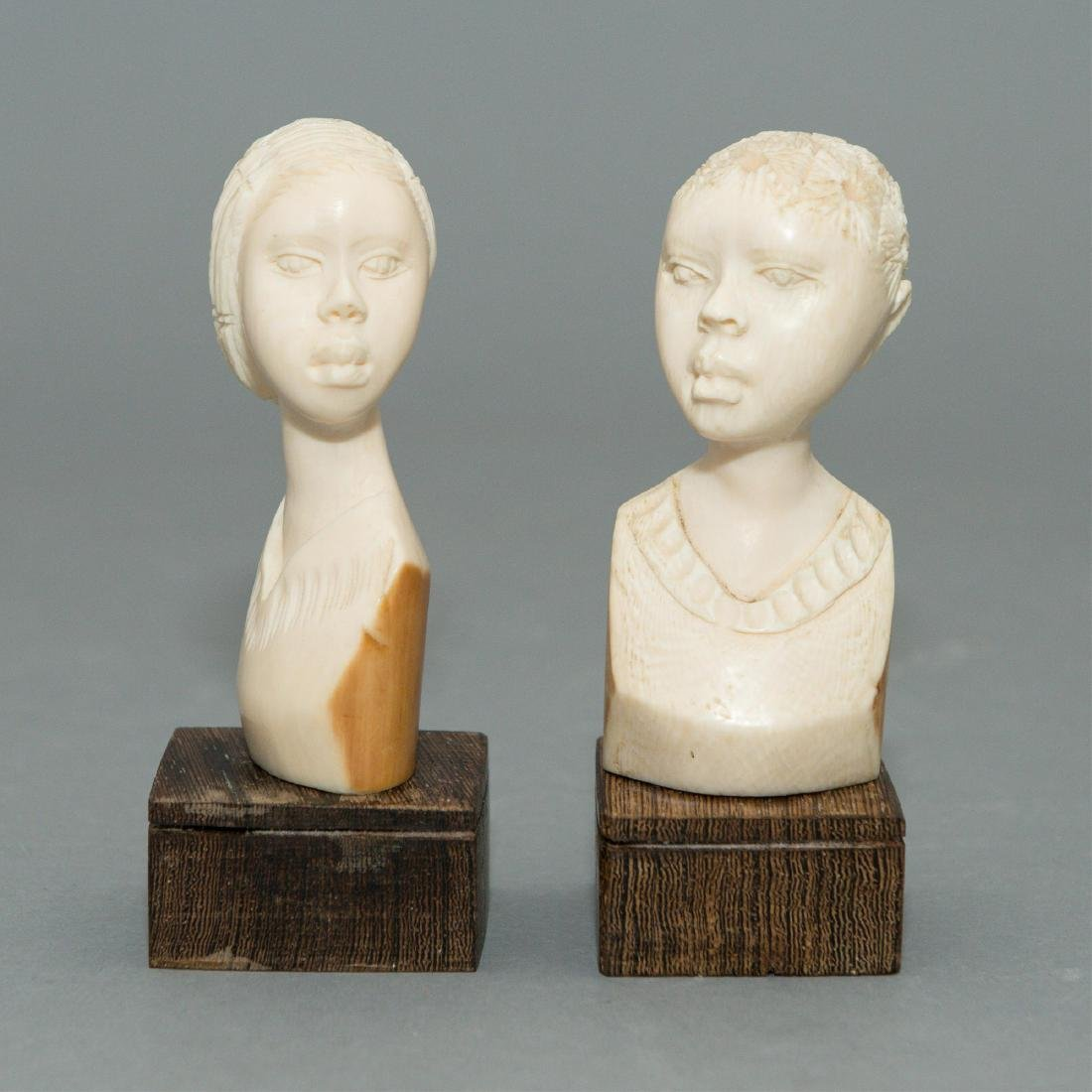 PAIR OF CARVED AFRICAN IVORY BUSTS, YOUNG WOMEN