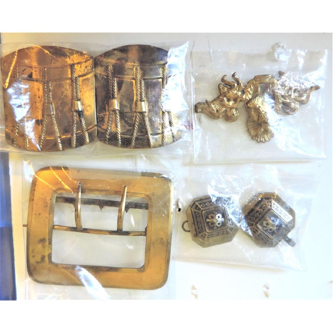 4 BRASS BUCKLES INCLUDING LARGE DRUM