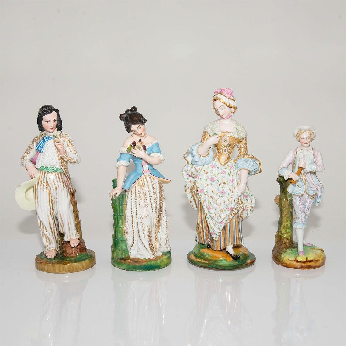 GROUP OF 4 ANTIQUE CONTINENTAL PORCELAIN STATUES