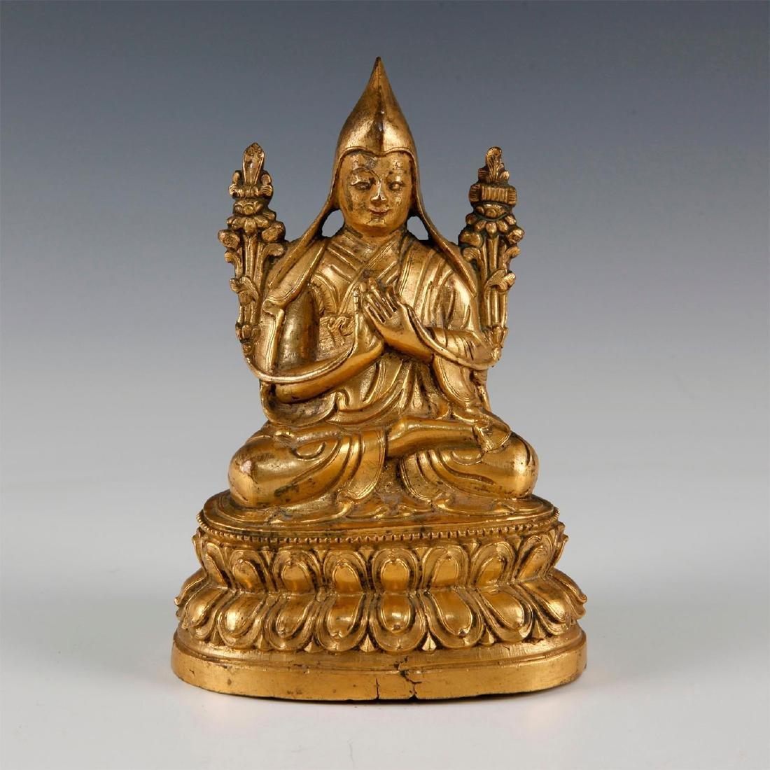 18TH CENTURY MOLDED GILT BRONZE TIBETAN LAMA FIGURE