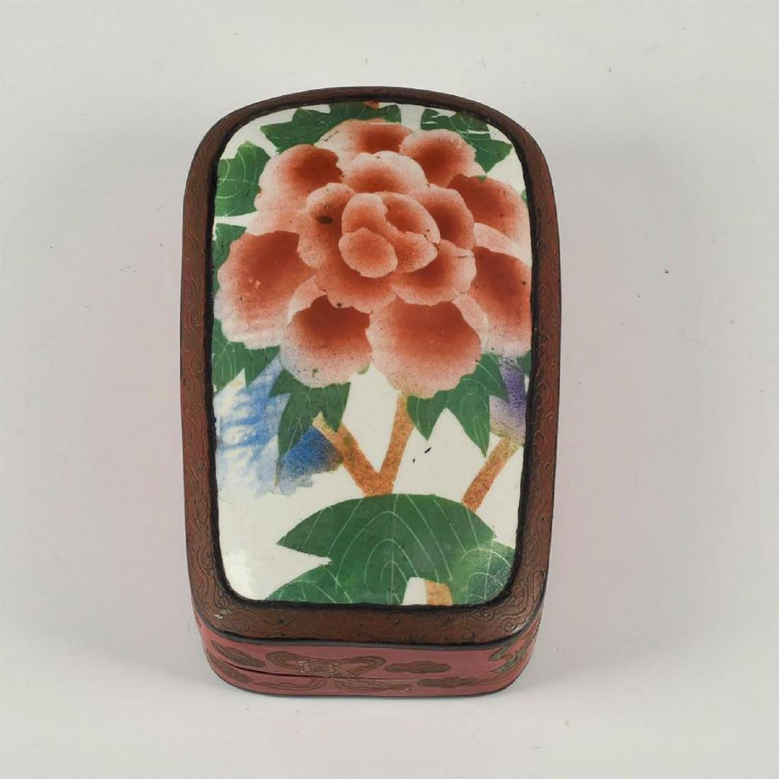 CHINESE RED LACQUERED WITH PORCELAIN SHARD INSET