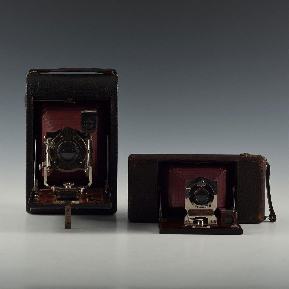 PAIR RICHLY APPOINTED WOOD AND CORDOVAN LEATHER CAMERAS