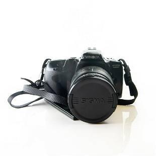 MINOLTA MAXXUM 400SI 35MM SLR WITH 28105 SIGMA ZOOM